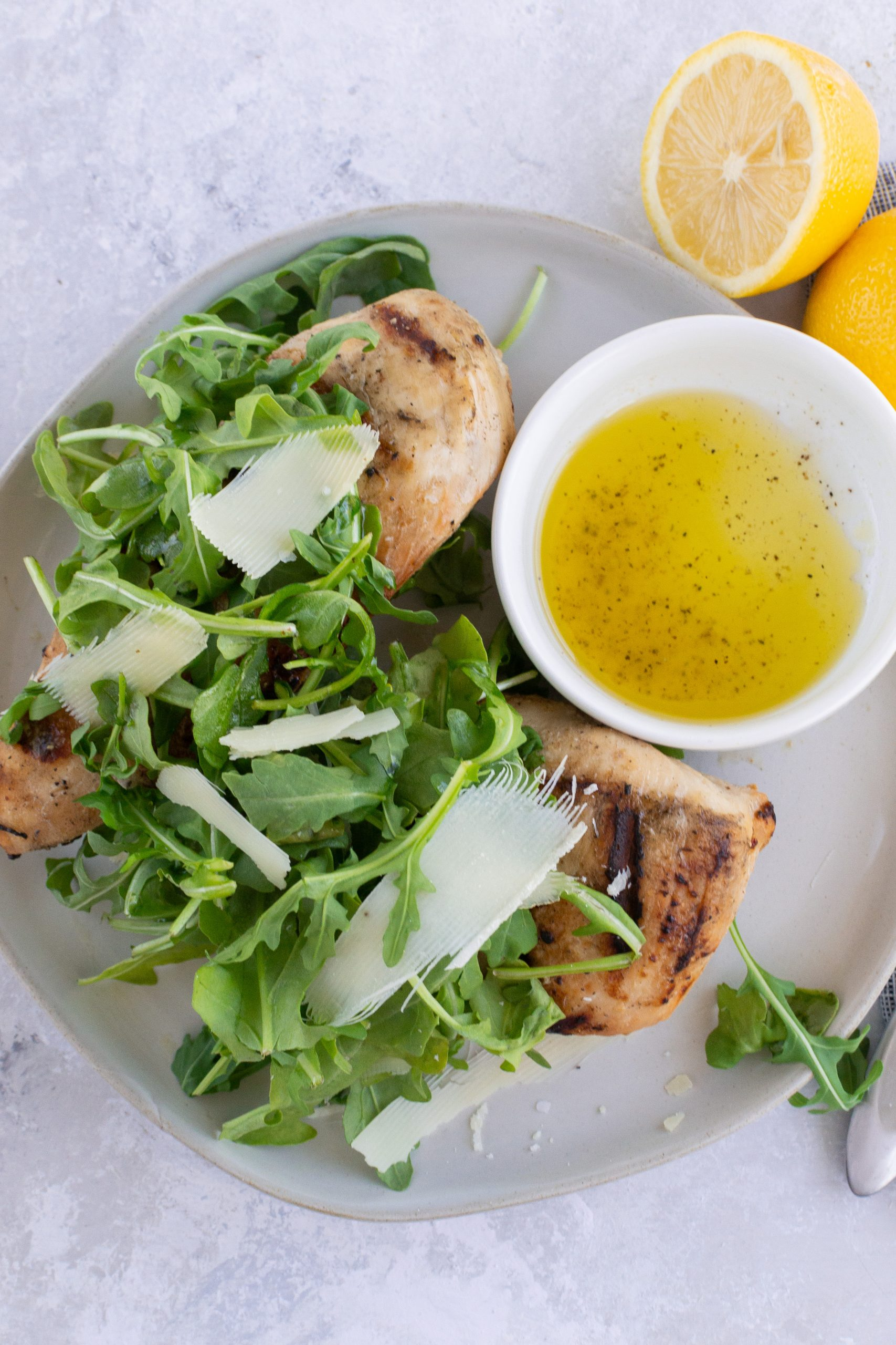 Grilled Chicken with Lemony Arugula Salad Topping