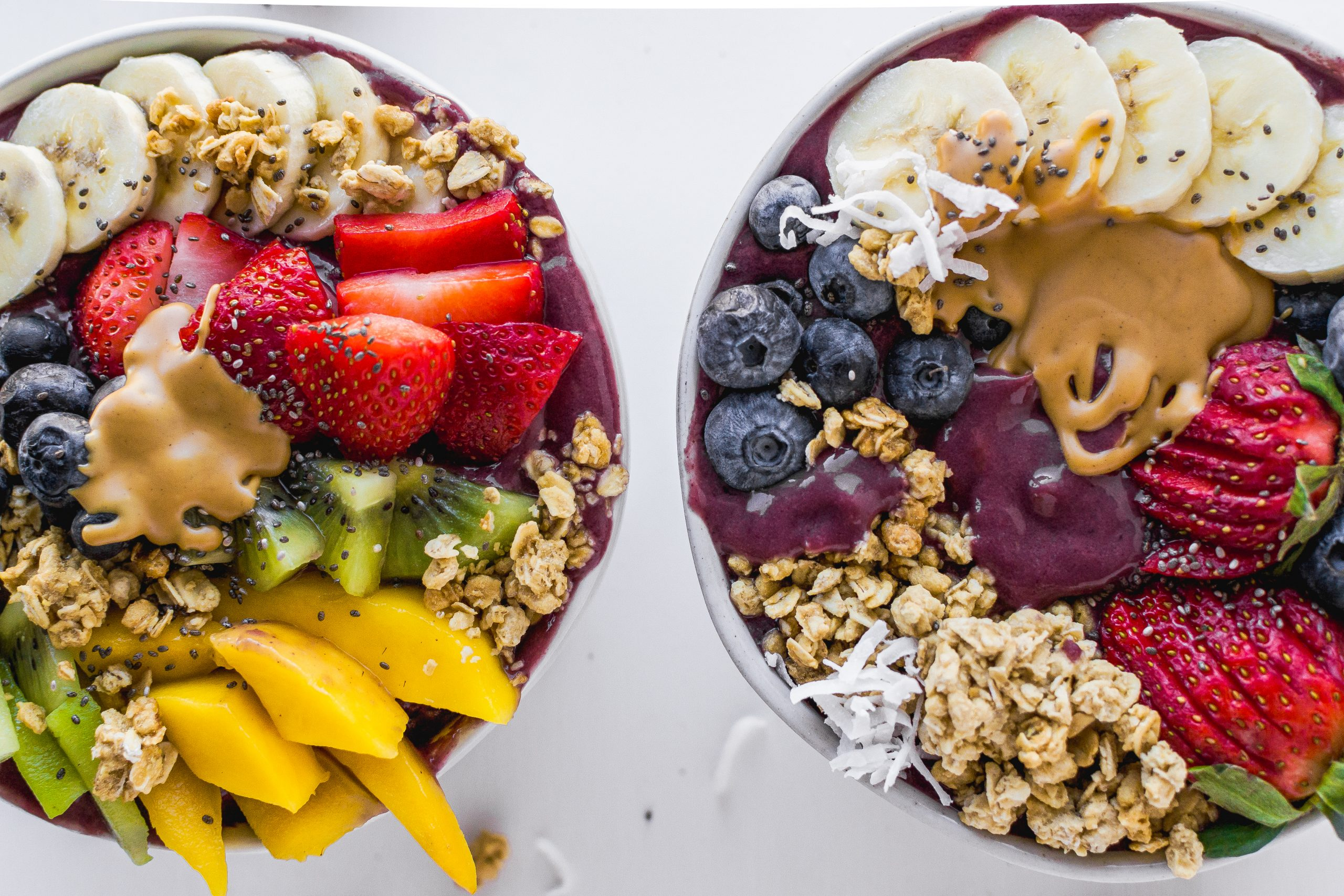 two different variations of acai bowls and toppings